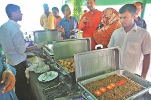 People throng Rodela Bikel, an Iftar outlet, to buy delicacies in MA Aziz Stadium Market of Chittagong city. Photo: Star