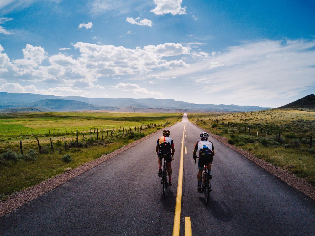 Two boys having fun and riding bikes