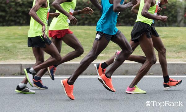Marathon runners racing image.