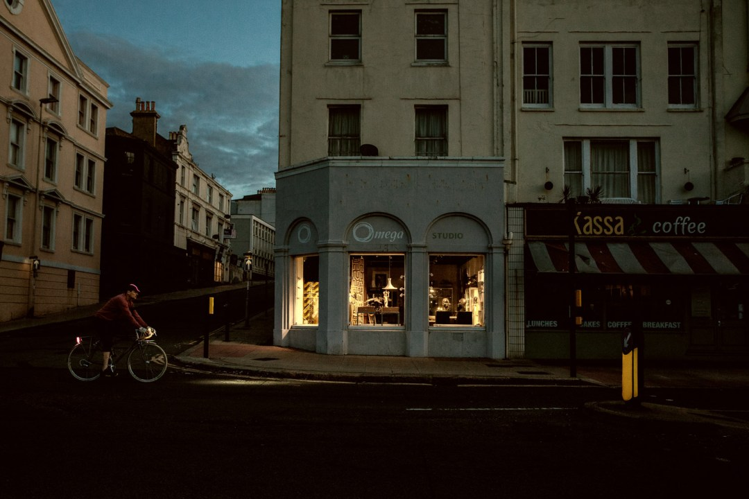 Bicycles in the Landscape series - a cyclist on a dark city street corner that resembles Edward Hopper's Nighthawks