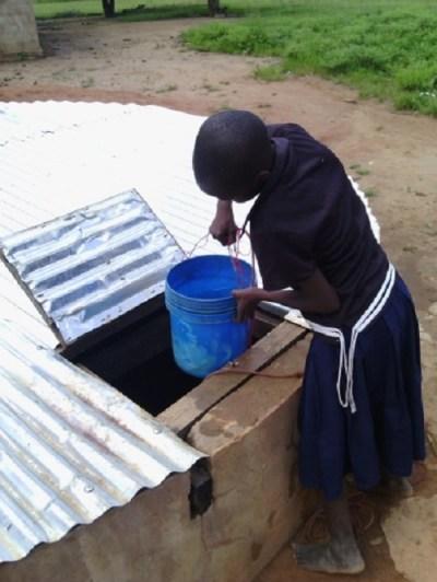 TanzaniaWaterCatchment_girlbucket_lg