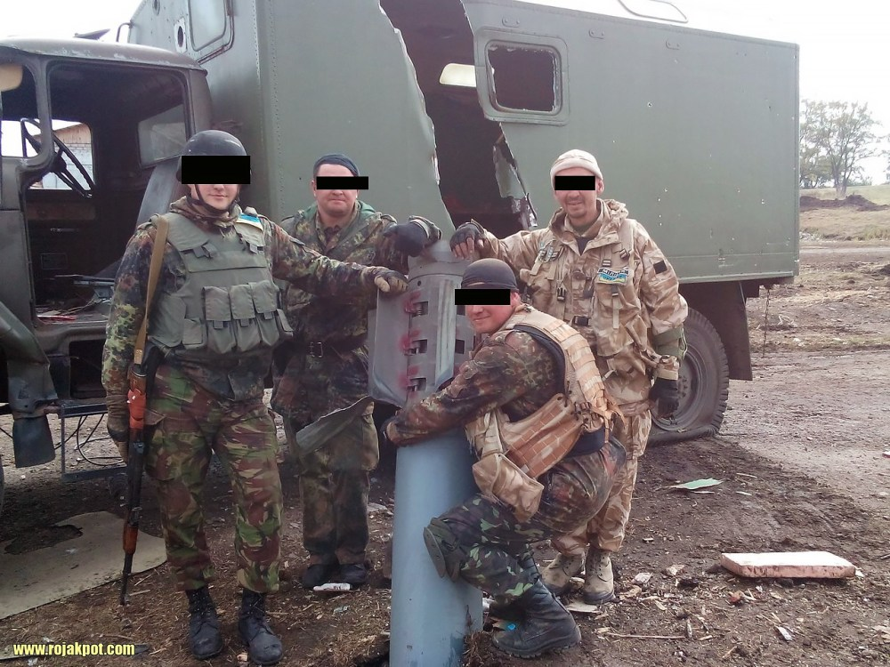 Soldiers get a group photo with the Russian rocket that didn't kill them