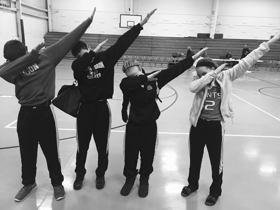 A group of teens dabbing | Credit : Wikimedia Commons
