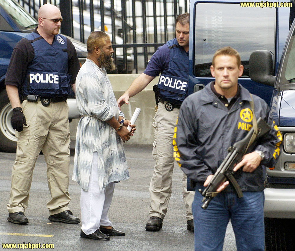Federal Marshals escort Mohammed Hossain out of the Leo O'Brien Federal building