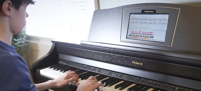 Student using Roland HPi-50 piano with DigiScore