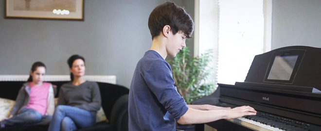 Student playing a digital piano