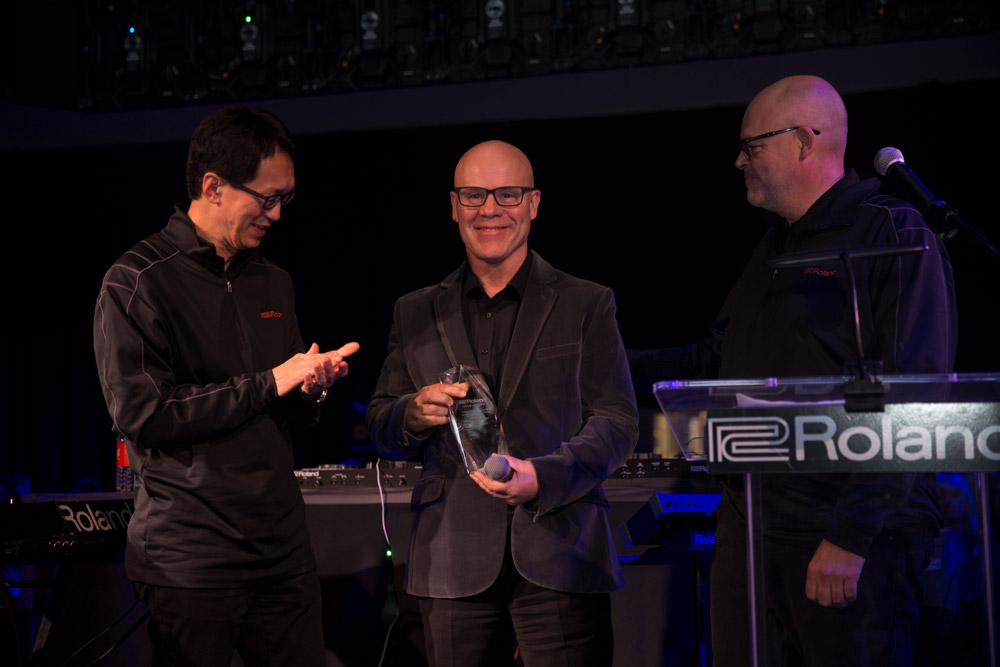 Roland Corporation CEO and Representative Director Jun-ichi Miki, Thomas Dolby, and Roland Corporation Vice President of Global Marketing Paul McCabe (left to right).