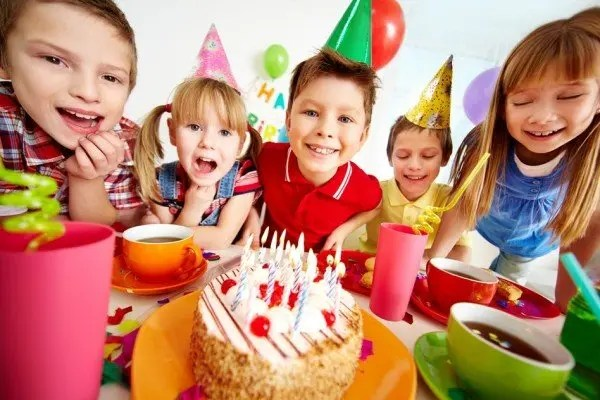 Children enjoying a birthday cake at a party.