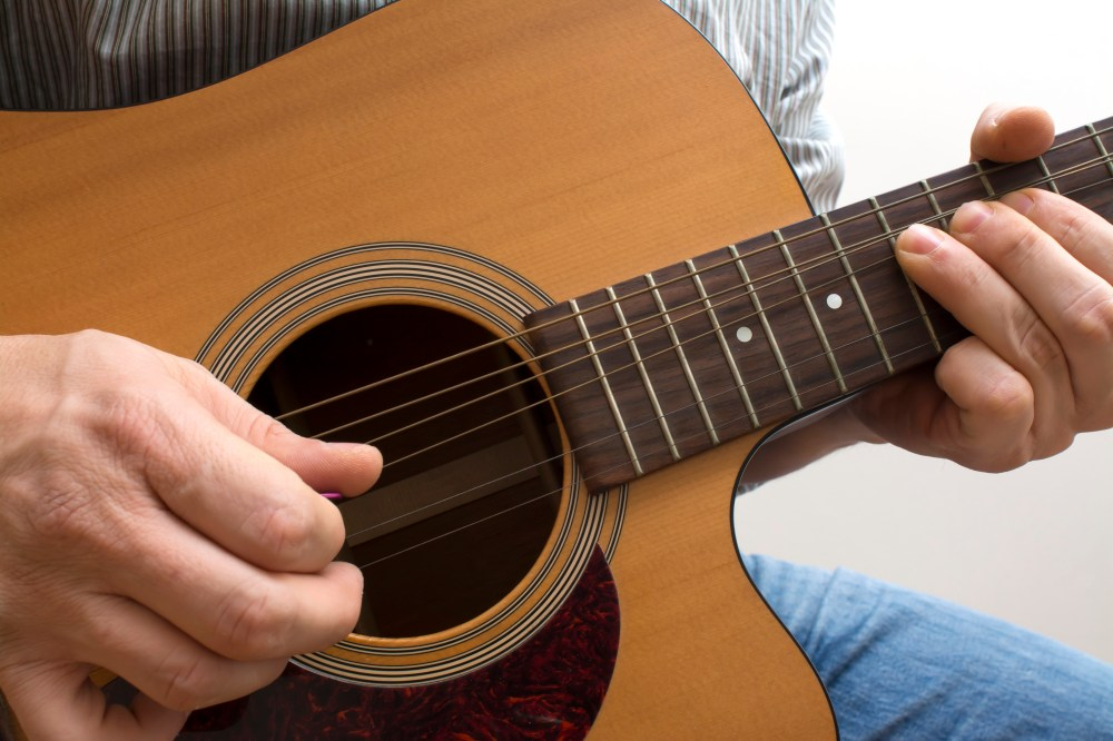 medium resolution of how to write a country song rolling stone acoustic guitar being played