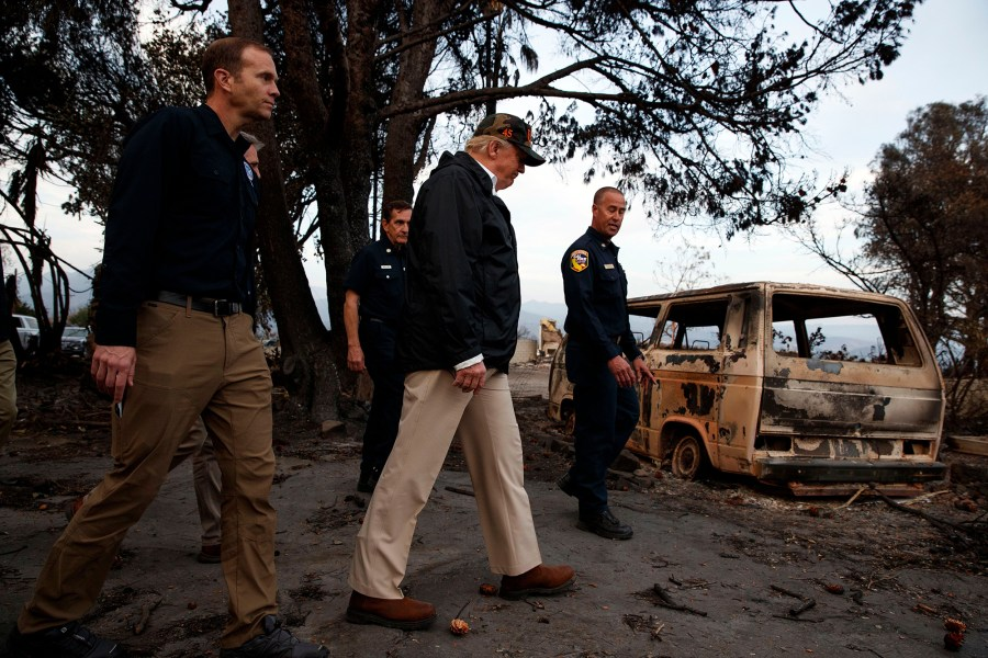 President Donald Trump walks with FEMA Administrator as he visits a neighborhood impacted by the Wolsey Fire