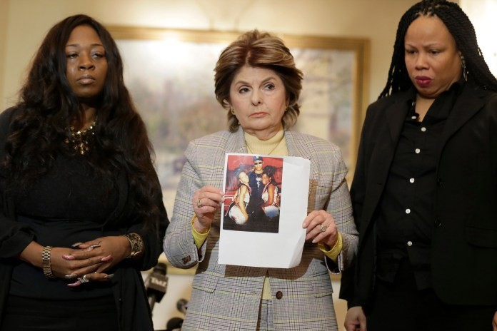 Gloria Allred, Latresa Scaff, Rochelle Washington. As Latresa Scaff, right, and Rochelle Washington, left, look on as attorney Gloria Allred holds up a picture of them as teenagers on the night they claim they became victims of musician R. Kelly's sexual advances during a news conference in New York, . Scaff and Washington are accusing musician R. Kelly of sexual misconduct on the night they attended a concert of his while they were teenagersR Kelly Investigations, New York, USA - 21 Feb 2019