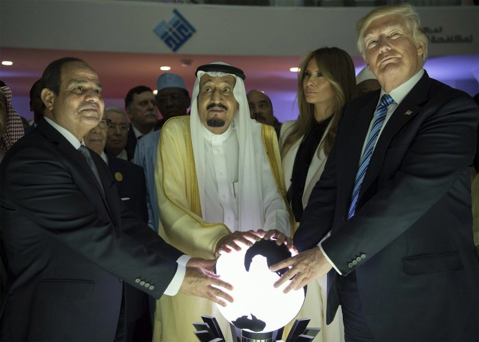 "RIYADH, SAUDI ARABIA - MAY 21: (----EDITORIAL USE ONLY MANDATORY CREDIT - ""BANDAR ALGALOUD / SAUDI ROYAL COUNCIL / HANDOUT"" - NO MARKETING NO ADVERTISING CAMPAIGNS - DISTRIBUTED AS A SERVICE TO CLIENTS----)US President Donald Trump, US First lady Melania Trump (2nd R), Saudi Arabia's King Salman bin Abdulaziz al-Saud (2nd L) and Egyptian President Abdel Fattah el-Sisi (L) put their hands on an illuminated globe during the inauguration ceremony of the Global Center for Combating Extremist Ideology in Riyadh, Saudi Arabia on May 21, 2017. (Photo by Bandar Algaloud / Saudi Royal Council / Handout/Anadolu Agency/Getty Images)"