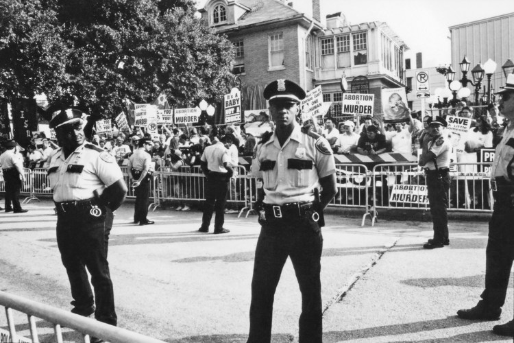 1992 Republican National Convention Protests. A phalanx of police offers protect Planned Parenthood from Operation Rescue protesters led by Randall Terry, who, with another leader was sentenced up to six months in jail and Operation Rescue was ordered to pay Planned Parenthood $1.1 million in damages for defying a restraining order during the GOP Convention on August 18, 1992 in Houston, Texas.