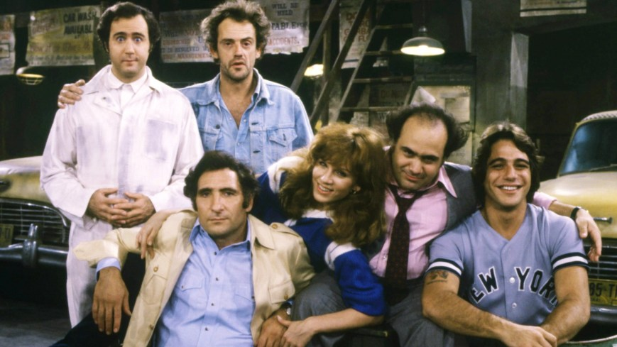 TAXI, standing from left: Andy Kaufman, Christopher Lloyd, seated from left: Judd Hirsch, Marilu Henner, Danny DeVito, Tony Danza, 1978-83.