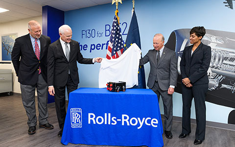 Unveiling an electronic engine controller for the Rolls-Royce AE 3007H jet engine during an announcement of a new engine controls facility in Discovery Park District are from left Brian Edelman, president of Purdue Research Foundation; Tom Bell, President - Defense and CEO of Rolls-Royce North America; Mitch Daniels, Purdue University president; and Candice Bineyard, Director of Defense Programs for Rolls-Royce. (Purdue University photo/Rebecca McElhoe)