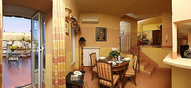 Rome domes the dining room and the open plan kitchen of the fine two bedroom apartment with two