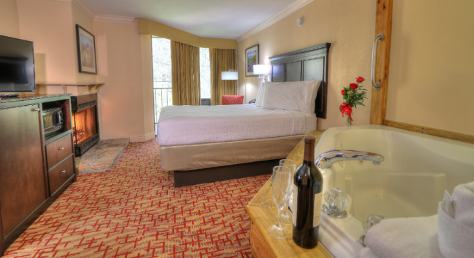A Jacuzzi And Fireplace Room in The Edgewater Hotel in Downtown Gatlinburg TN