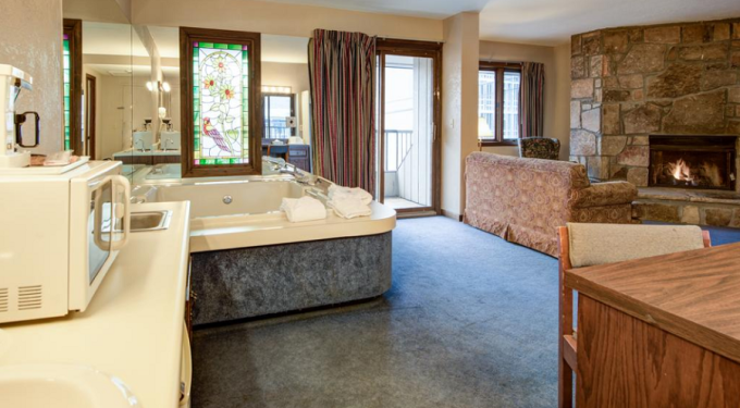 A Jacuzzi Fireplace Room in Sidney James Mountain Lodge in Downtown Gatlinburg TN - one of the most romantic hotels in Gatlinburg