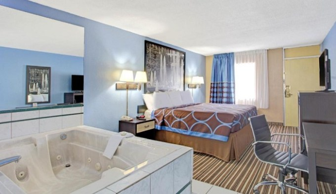 King studio suite with a private jetted tub in the room in Super 8 by Wyndham Memphis-Dwtn-Graceland Area, TN