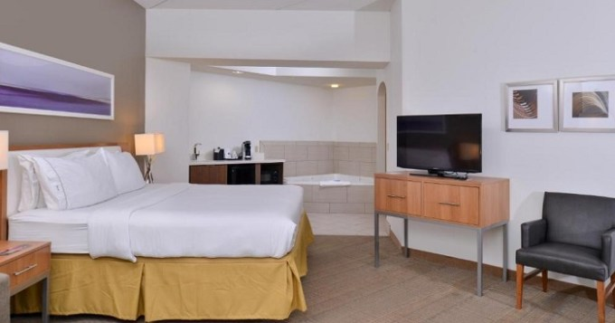 Suite with a hot tub in the room in Holiday Inn Express and Suites New Orleans Airport Hotel