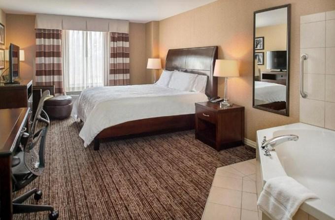 Room with a hot tub in Hilton Garden Inn St. Louis Airport, MO