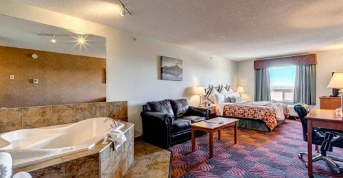 A Romantic Spa Suite with a hot tub in the bedroom in Service Plus Inn and Suites Calgary, Alberta, Canada