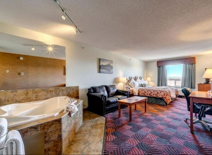 Romantic Spa Suite with a hot tub in the bedroom in Service Plus Inn and Suites Calgary, Alberta, Canada