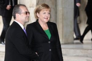 Merkel i-a cerut lui Boc banii înapoi