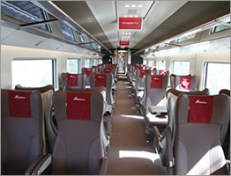 Frecciarossa's Premium class seats are leather and have a reclining backrest. (Credit: Trenitalia)