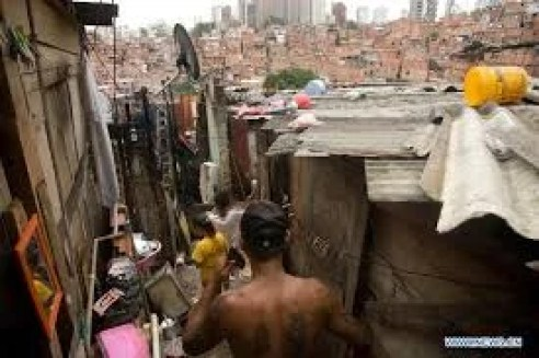 Life among the desperate--favelas of Sao Paulo Brazil with skyscrapers in the background.