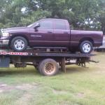 Truck out of the lake and on Ronnie's flatbed towtruck