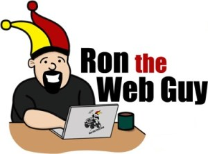 ron the web guy at desk with laptop