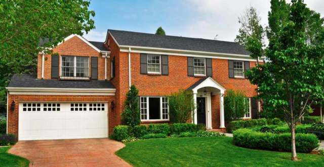 Gable Roof on a House with a Brick Siding