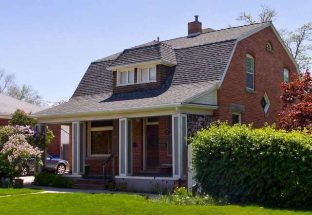 Gambrel Roof House with Brick Siding