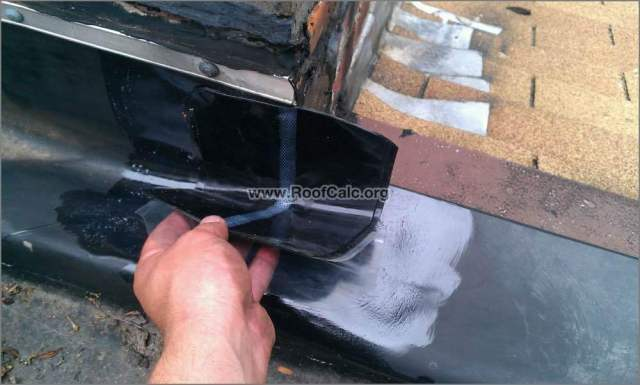 Install corner patch on rubber roof