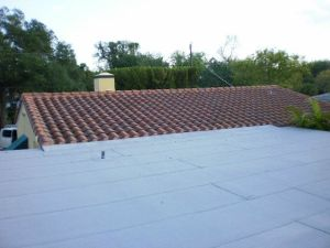 Flat roof and tile roof in Biscayne Park