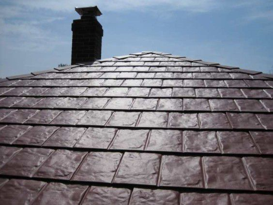 red-metal-shingles-roof-top