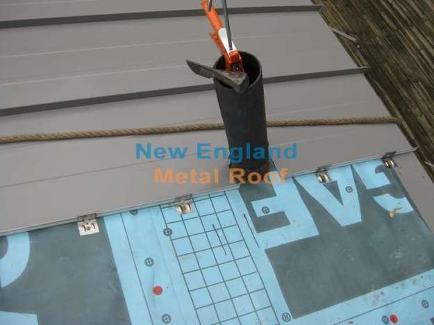 installing a metal panel around the roof pipe