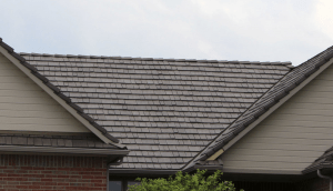 Polymer roofs installed by Heiland Roofing and Exteriors, Wichita, received very little if any damage during the microburst.
