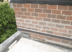 PHOTO 9: The through-wall flashing has been raised to a new height to accommodate the additional insulation.