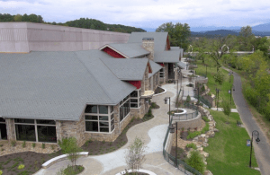 Topping off the LeConte Center at Pigeon Forge is 965 squares of Valoré Slate polymer roofing tiles from DaVinci Roofscapes in the Verde blend of light and dark green tiles, which complement the facility's Smoky Mountain setting.