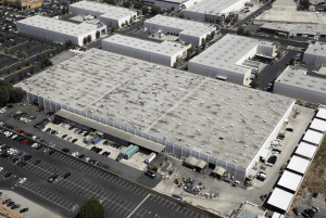 This photo shows the American International Industries roof before work began on the restoration project. The roof diaphragm on the 210,000-square-foot, wood-frame manufacturing facility in Los Angeles had deflection caused by structural settlement. Photo courtesy of Highland Commercial Roofing.