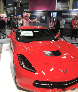 Chris Amiot (left) of Advantage Construction Inc. was awarded the grand prize of a 2017 Chevrolet Corvette Stingray Coupe in Owens Corning's 2017 Accelerate Sweepstakes.