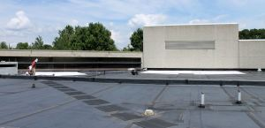 The roof of the Virginia-Maryland College of Veterinary Medicine at Virginia Tech is the site of the experiment because it has opaque and glazed wall areas adjacent to a low-slope roof.