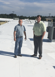 Anthony Wilkerson (left) and Blake Wideman of Peach State Roofing's Charlotte branch inspect the completed project at Premium Outlets in Gaffney, S.C.