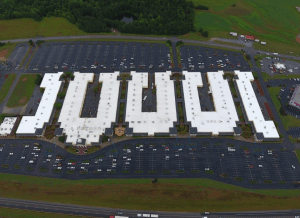 This aerial view shows the five buildings of the Gaffney Premium Outlets mall. Peach State Roofing re-roofed the two buildings on the left this year, after completing work on the building at the far right last year.