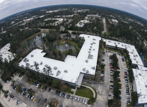 The roof was replaced on Huntsman Corporation's Advanced Technology Center, an L-shaped, 70,000-square-foot facility housing expensive equipment and research labs. A TPO membrane roof system was installed over high-density polyiso cover board.