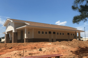 St. David's Episcopal School's new field house features an architectural shingle roof designed to provide long life and protection from algae growth. Photo: Atlas Roofing.