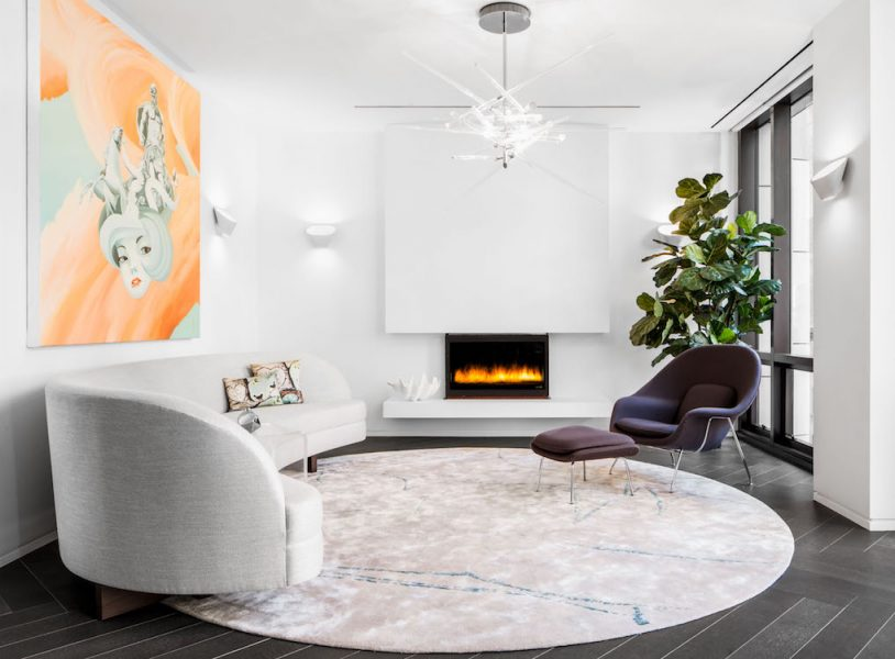 white curved sofa with fireplace