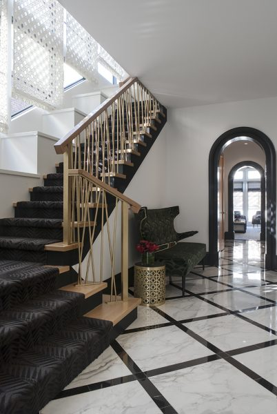 grand entryway, grand foyer, luxurious foyer, marble tile, gold staircase, black runner